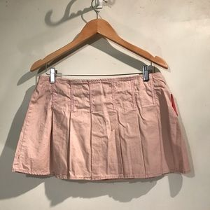 Cute pink pleated mini skirt.